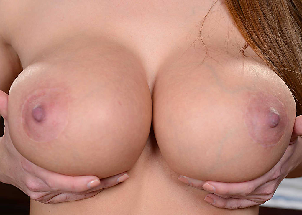 Large women with bare breasts